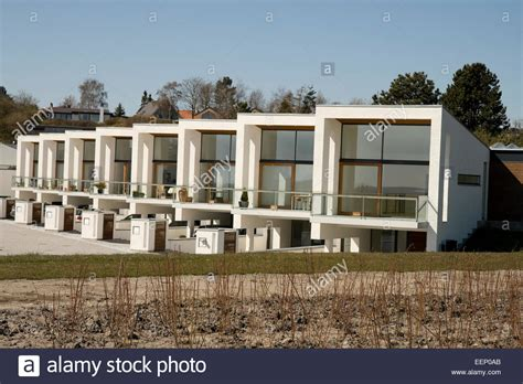modern row house modern row houses near the coast at aarhus denmark stock