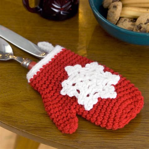 easy crochet christmas crafts snowflake mitten ornament crochet pattern from yarn favecrafts