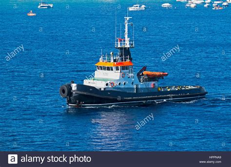 Tug Boat Shoppinf a tug boat in the mediterranean sea near the town of palamos in spain stock photo royalty free