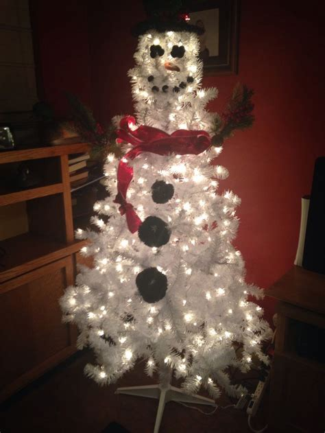 snowman made out of a white christmas tree holiday