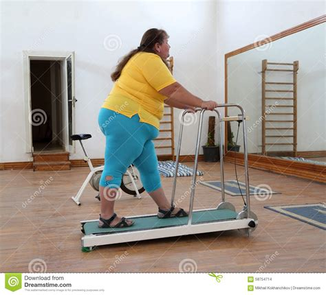 how to a to run on a treadmill overweight running on trainer treadmill stock photo image 58754714