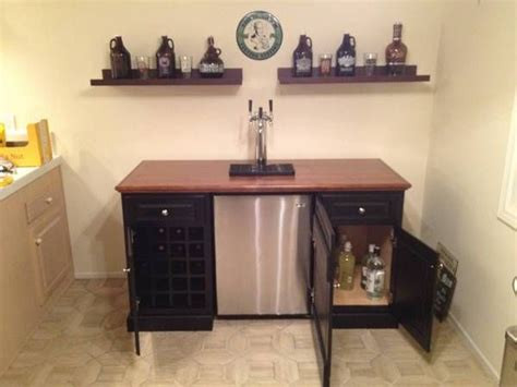 bar cabinet with mini fridge don t need a kegerator but it would be neat for a mini