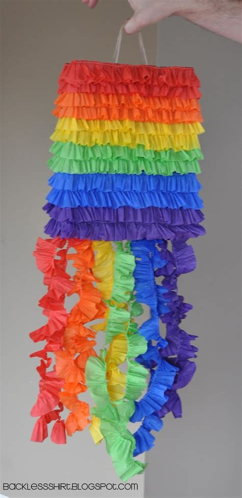 diy pinata using a paper sack w a handle on top to hang