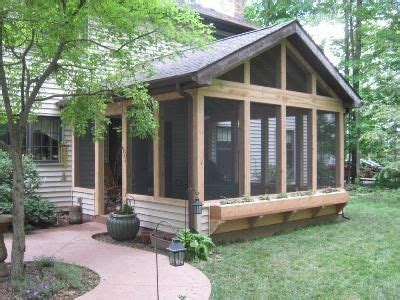 log cabin front porch archadeck outdoor living screened in porch with fireplace rustic screened porch