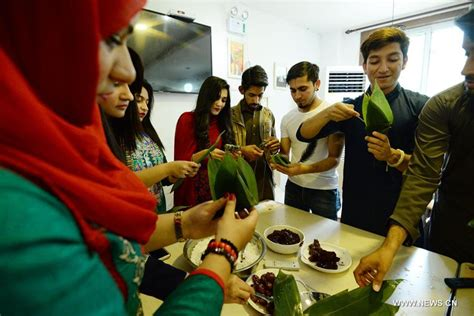 dragon boat festival and food foreign students make quot zongzi quot to mark upcoming dragon