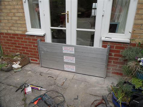 a flood barrier installation to a set of doors