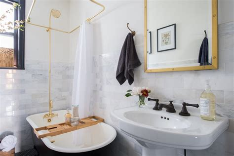 bathroom item that starts with y black and white bathroom with brass shower popsugar home