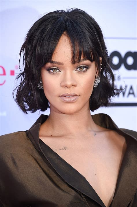 the newest look for ambre on bobs rihanna short hair see her cute new bangs and bob glamour