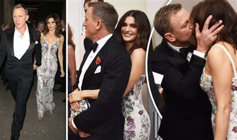 daniel craig clings onto his bond girls at spectre world daniel craig passionately kisses wife rachel weisz at