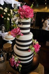 black and white cakes with a perfectly added pop of color