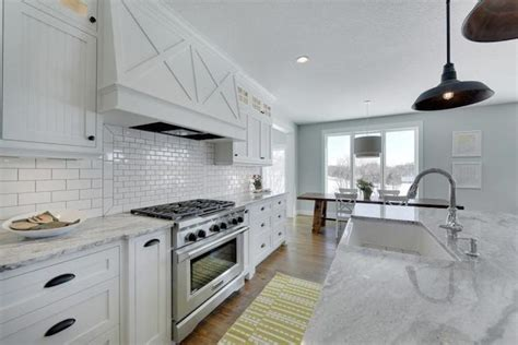 Kitchen Island With Cooktop And Seating Super White Granite Countertops Transitional Kitchen