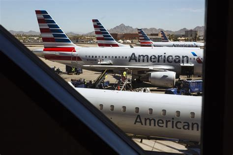 american airlines relents  allowing carry  bag  discount airfare bloomberg