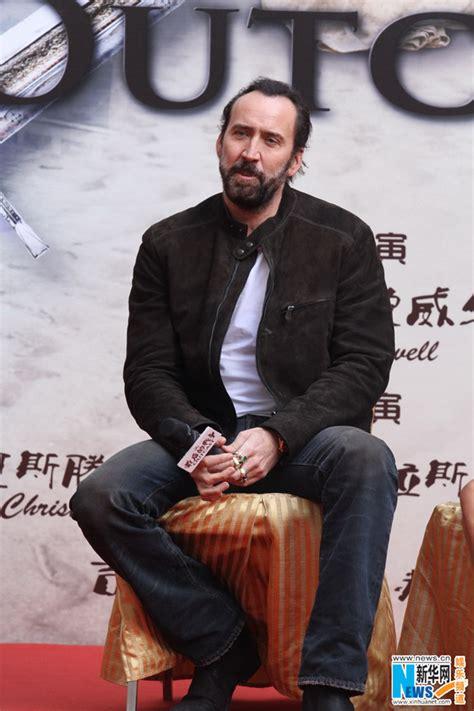 film nicolas cage en francais nicolas cage 224 beijing pour la promotion du film outcast