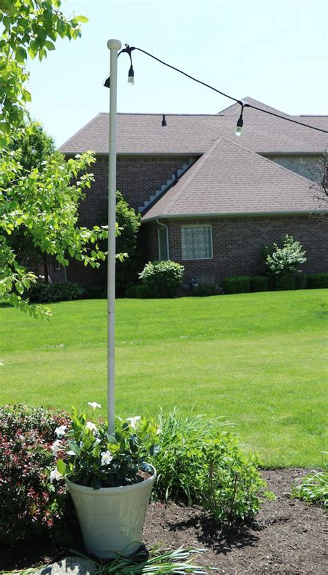 Outdoor String Light Pole Enbrighten Caf 233 Lights Diy Light Pole Planter Home Patio And Planters