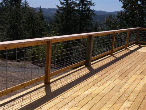 Hog Panel Deck Railing by This Cedar Deck Is Surrounded By Hog Panel Railing Hog