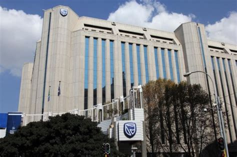 standard bank jse standard bank hit with r500m in fines on bribery charges