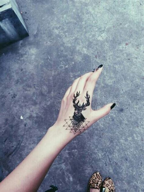 tattoo hand deer 16 wonderful deer tattoo images ideas and picture
