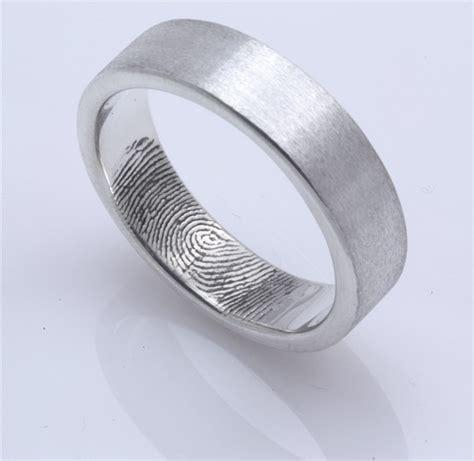 custom fingerprint wedding band with single fingertip whorl
