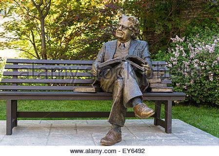 park bench toronto on the bench bronze sculpture by sculptor mackenzie thorpe outside stock photo