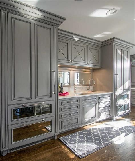 mirrored kitchen cabinets gray paneled refrigerator with mirrored freezer drawers