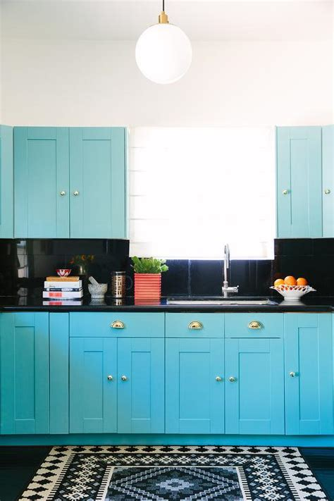 turquoise cabinets kitchen turquoise blue kitchen with black countertops and