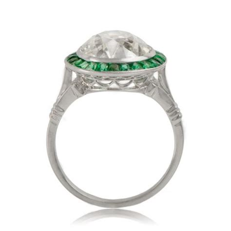 ring with emerald halo estate jewelry