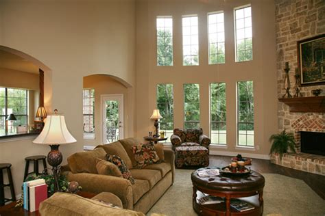 2 story living room decorating ideas what would you do w 2 story windows fireplace babycenter
