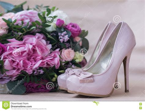 high heels with flowers beautiful wedding shoes with high heels and a bouquet of