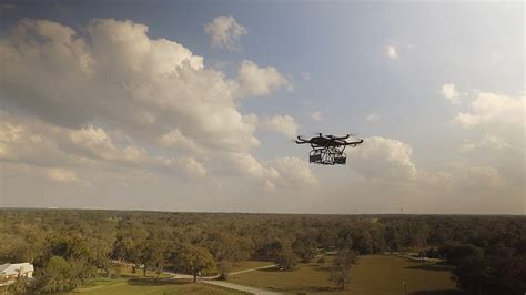 designboom drone ups delivery drone takes off from atop package car