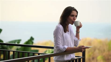 Stock Video Clip of Happy woman drinking coffee in the