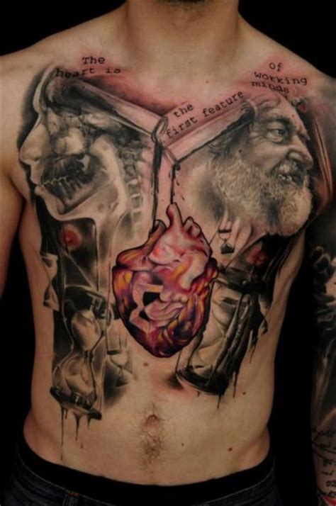 realistic chest belly tattoo by vicious circle tattoo