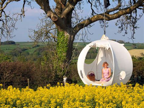 hanging tree house designs roomoon awesome moon shaped treehouse tents are perfect for summer gling roomoon