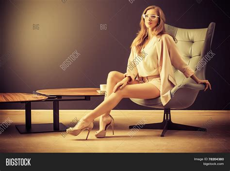 Model Sitting On Chair by Portrait Of A Beautiful Fashionable Model Sitting In A Chair In Nouveau Style Interior