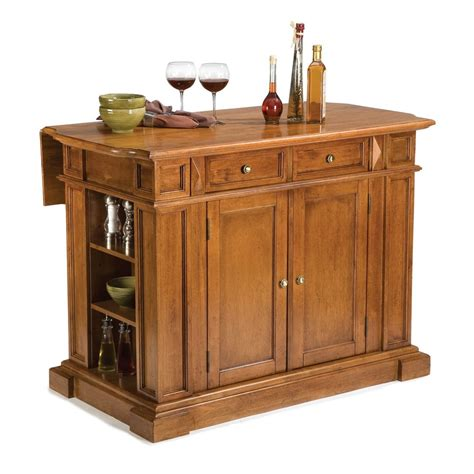 shop kitchen islands shop home styles brown farmhouse kitchen islands at lowes