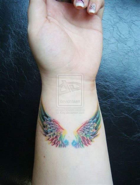 angel wrist tattoo best 25 wing tattoos ideas on