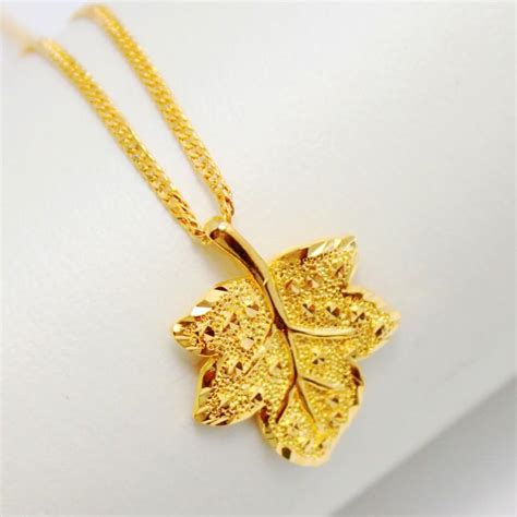 Anting Korea Leaves Shape Copper Earrings 1 3 exquisite maple leaf pendant gold pendant gold plated copper plated 24k gold content of