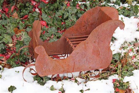 santa sleigh table decoration tin sled decoration santa s sleigh table centerpiece