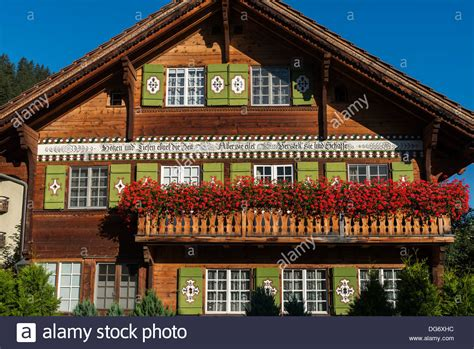 traditional alpine house stock photo image of blooming traditional wooden shuttered alpine house klosters platz