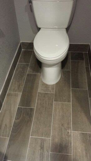 gray tile the tile baseboard bathroom