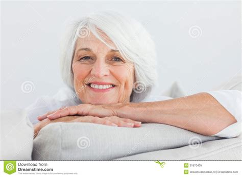 mature couch woman leaning on a couch royalty free stock images image