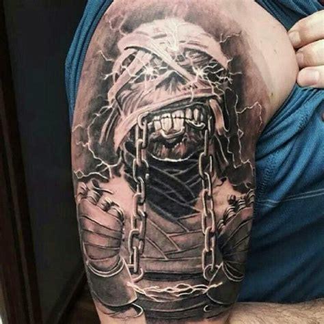 tattoo arm metal realistic looking detailed upper arm tattoo of mummy