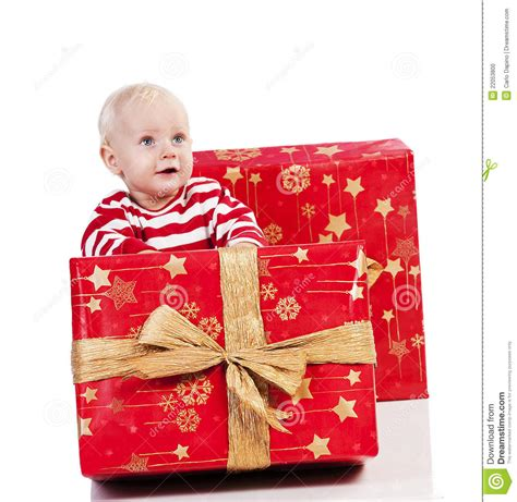 christmas baby boy with gift box baby is sitting stock