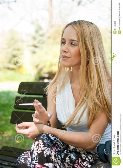 young girl smoking cigarette stock photos images young woman smoking cigarette outdoors royalty free stock