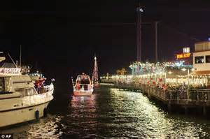 boat lights in kemah sailors light up the night with festive christmas boat