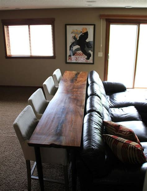couch movies bar table and seating behind a couch perfect for a