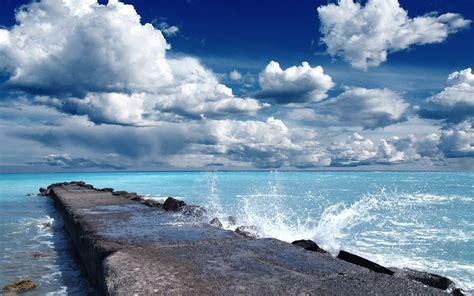 nature landscape clouds pier rock waves water sea
