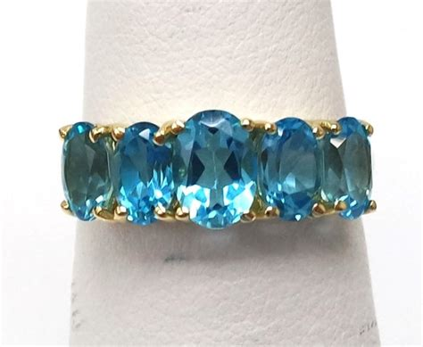 Topaz 5 14ct 14ct yellow gold 5 oval cut blue topaz ring size n 1 2
