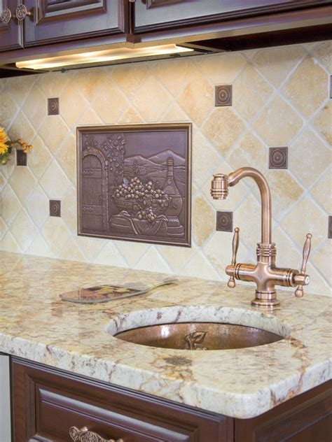 kitchen with white cabinets backsplash and bronze accents backsplash with bronze accents kitchen remodel ideas
