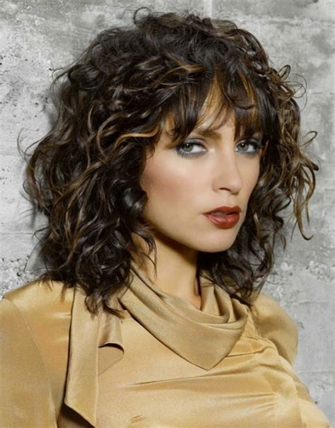 pictures of the ladies long curly layered haircut called the gypsy cut from the 1970s layered curly hairstyles for womens of all ages fave