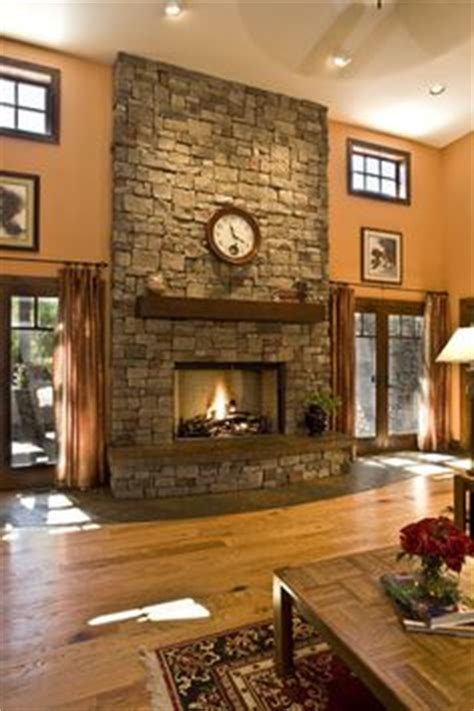 Pumpkin Spice Paint Living Room reminds me of home with our floor to ceiling fireplace and big windows on each side